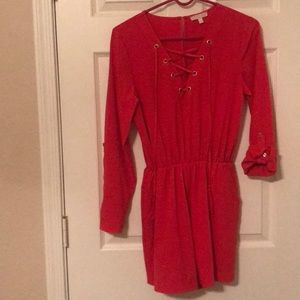 red romper, sleeves can be rolled up/ kept down
